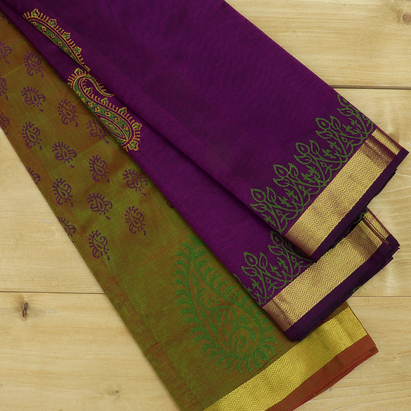 silk cotton half saree  mandulir shade with paisley block prints golden zari border and contrast purple dupatta