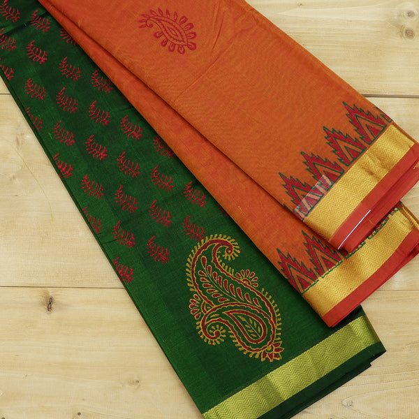 silk cotton half saree green with paisley block prints golden zari border and contrast golden orange dupatta