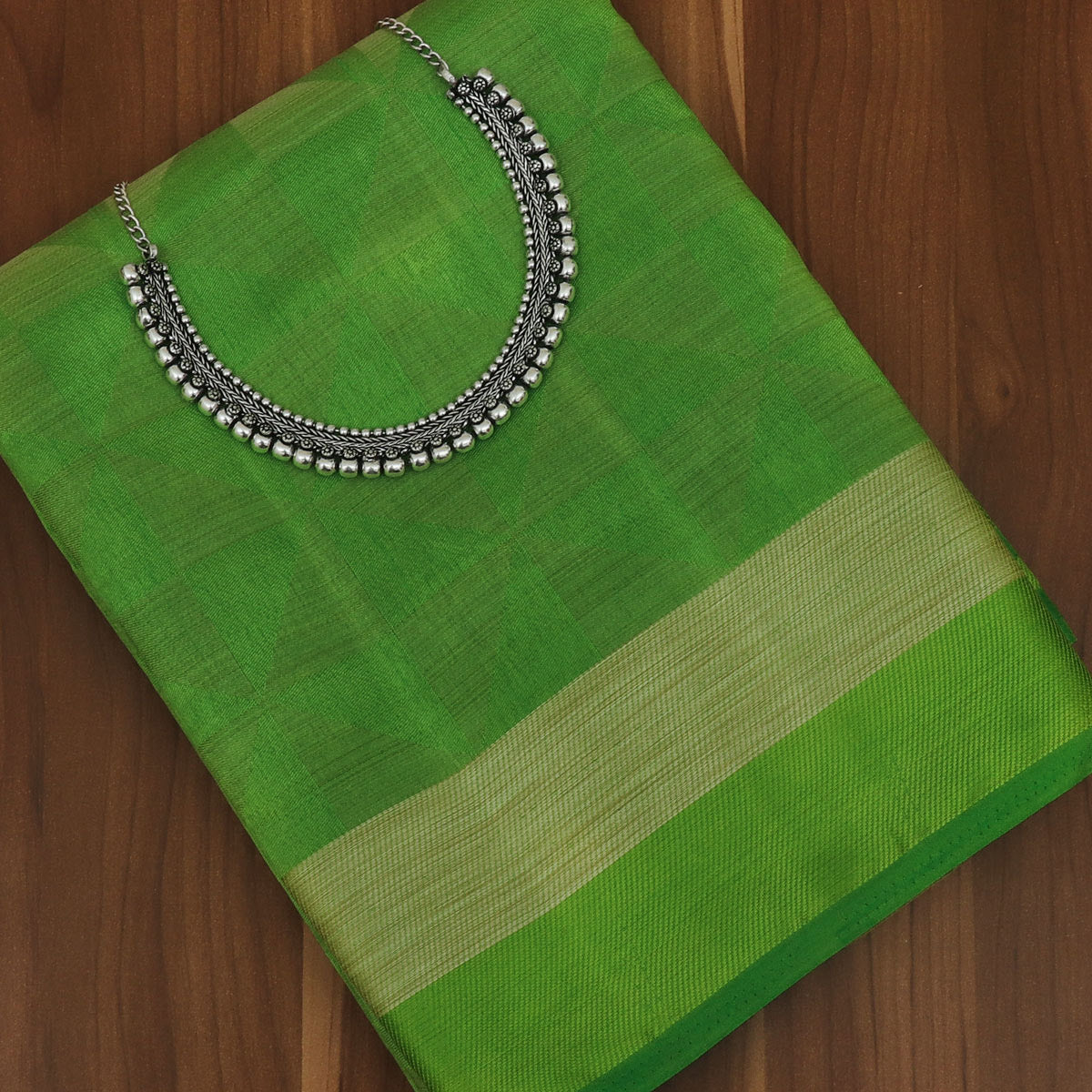 Raw Silk Saree Parrot Green Shade with Simple border and jewel