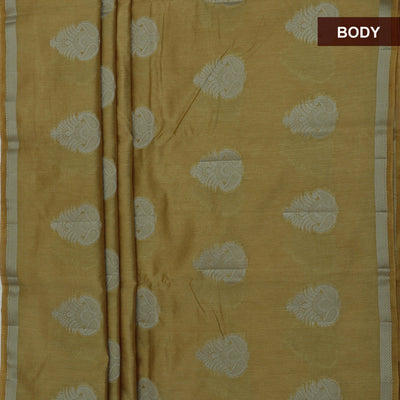 Raw Silk Saree Golden color with Simple border and jewel