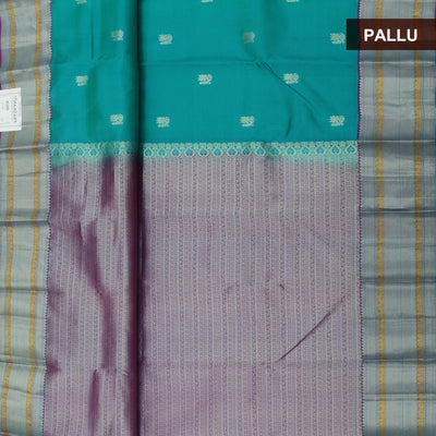 kanjivaram Silk Saree Teal Blue and Purple with Butta and Mango Silver border
