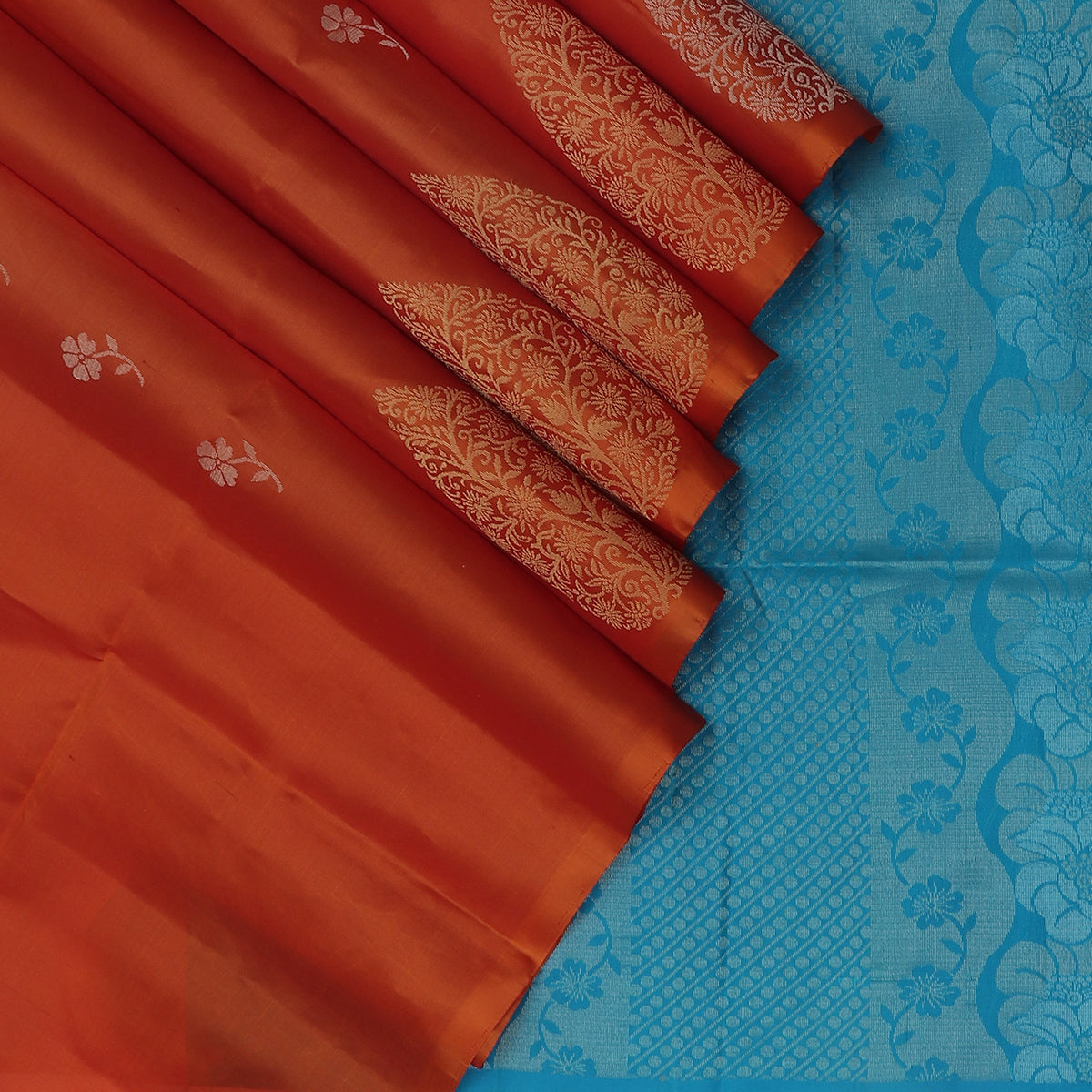Soft Silk Saree Brick Orange with Flower buttas and silver Zari Border