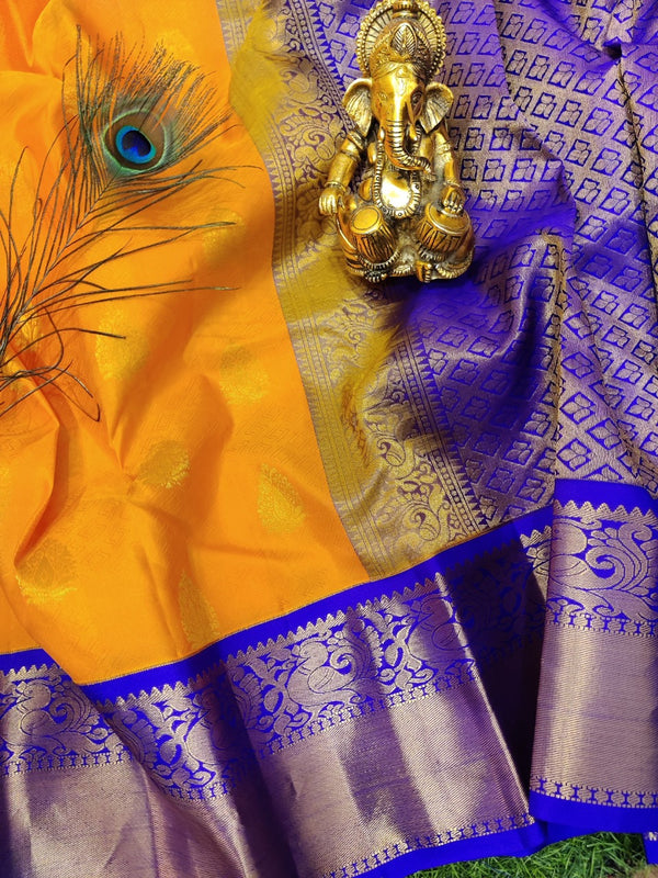 Pure Kanchivaram Silk saree orange and violet with self emboss and buttas with rich zari woven border