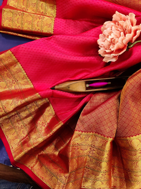 Pure Kanchivaram Silk saree reddish pink with allover self emboss and zari woven border