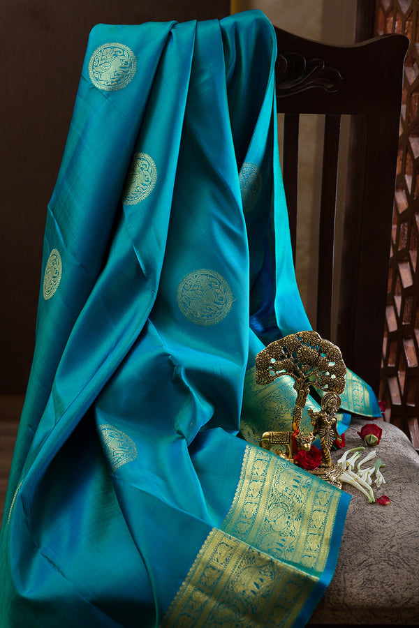 Kanjivaram silk sarees Teal Blue with buttas and annam zari Border