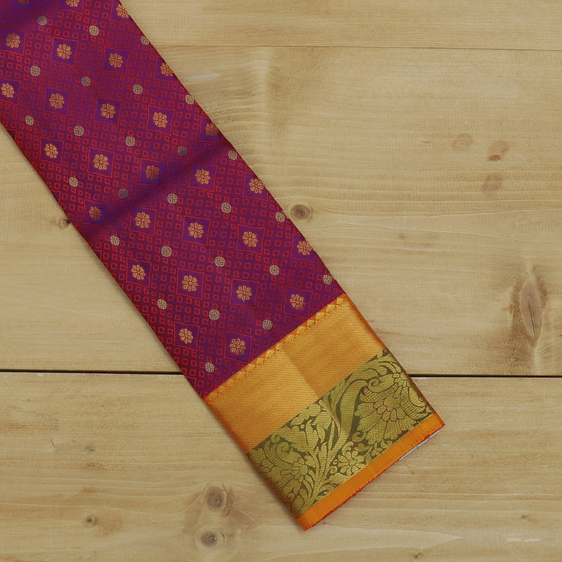 Pure silk pavadai material dual shade of violet and mustard yellow with overall self emboss and golden zari floral border for 0 to 2 years