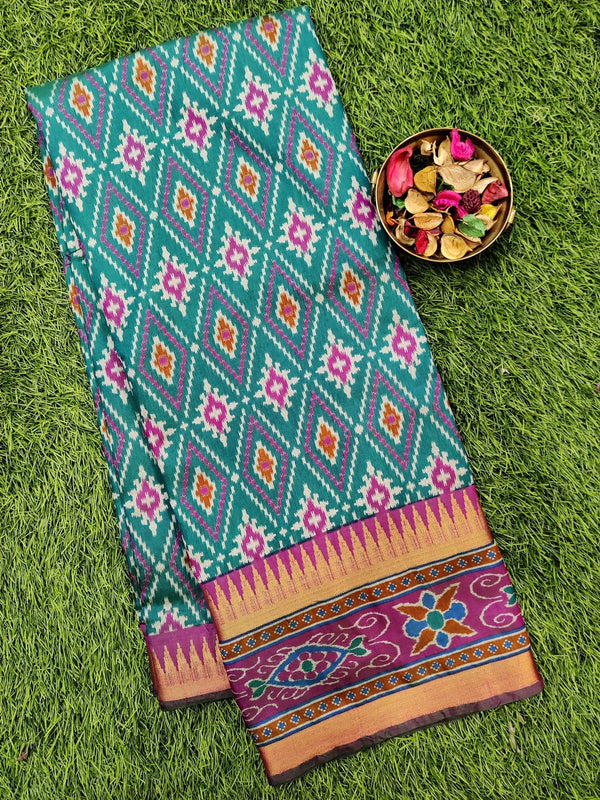Semi tussar saree peacock green and magenta pink with ikkat prints and zari border