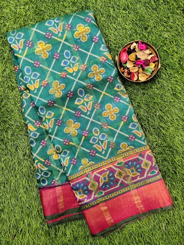 Semi tussar saree green and pink with ikkat prints and zari border