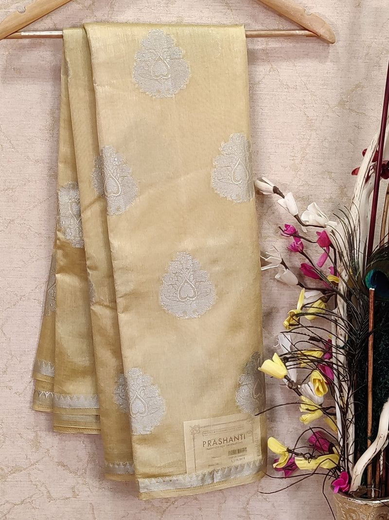 Semi raw silk saree cream with body buttas and border