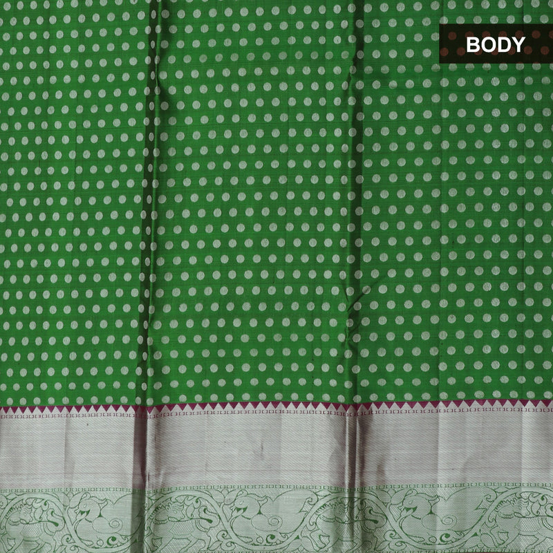 Pure Silk half saree bottle Green with all over silver zari butta and contrast pink blouse and dupatta