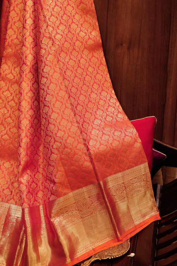 Pure Kanjivaram silk saree dual shade of orange with overall golden zari floral buttas and border