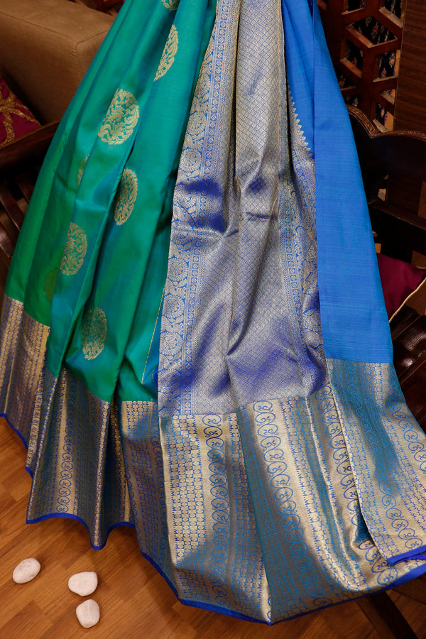 Pure Kanjivaram silk saree dual shade of pastel green and blue with golden zari floral buttas and long border
