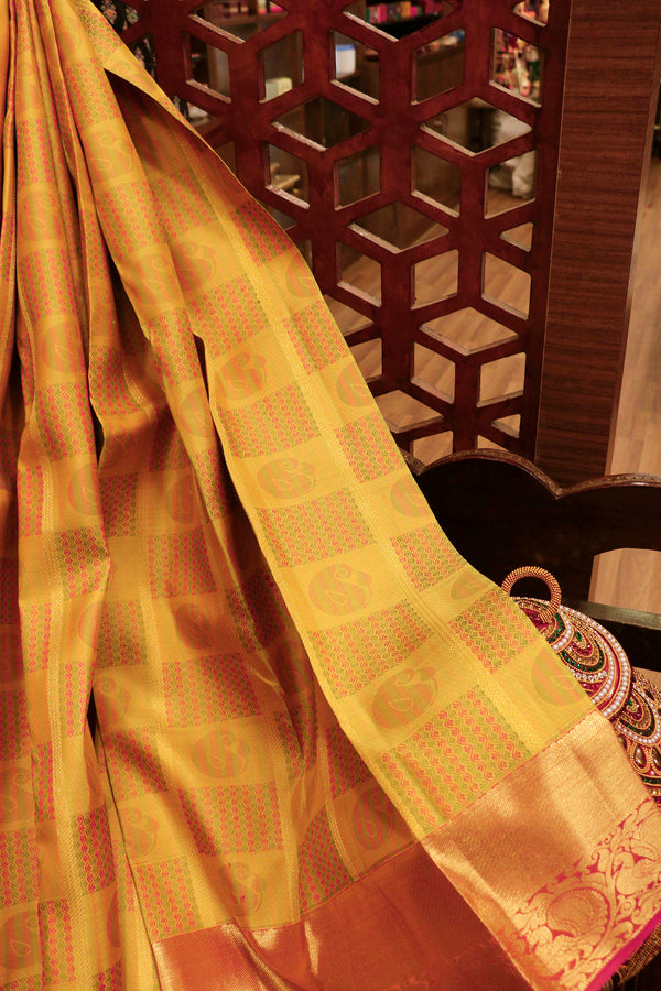 Pure Kanjivaram silk saree yellow and pink with golden zari lines and thread buttas checked pattern with long zari peacock border