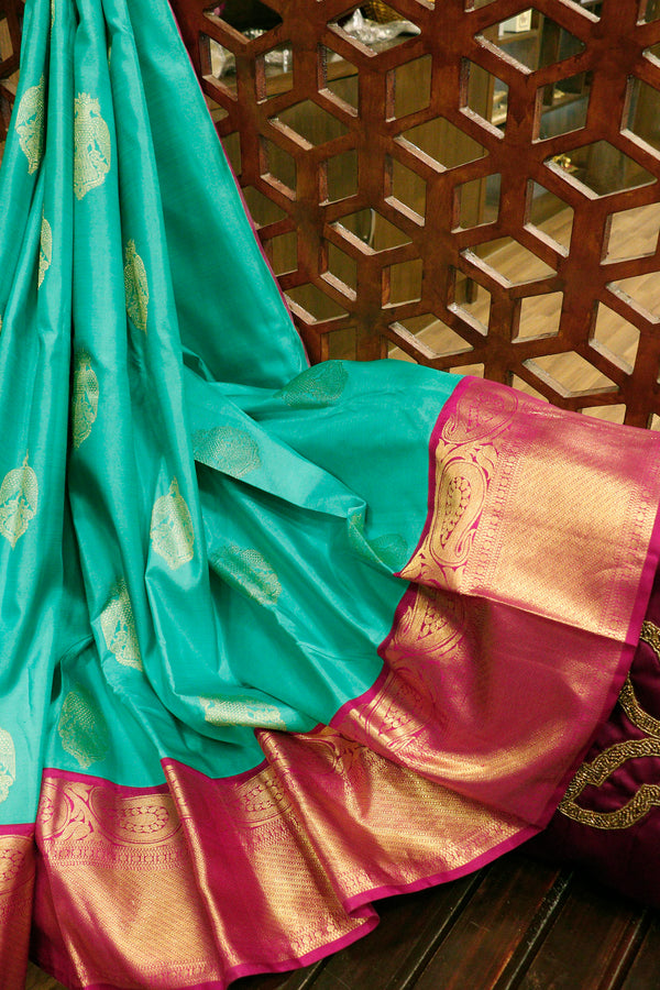 Pure Kanjivaram silk saree teal green and magenta with golden zari buttas and long paisley zari border