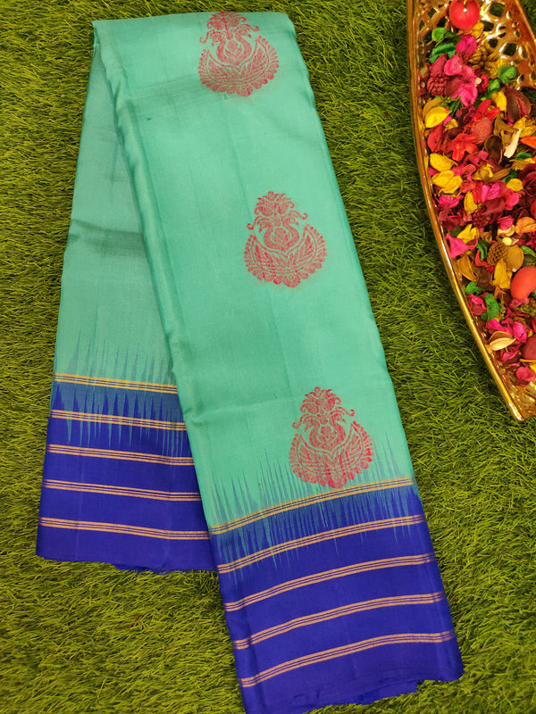 Pure Soft silk saree teal blue and royal blue with lines of silver zari abd thread woven buttas
