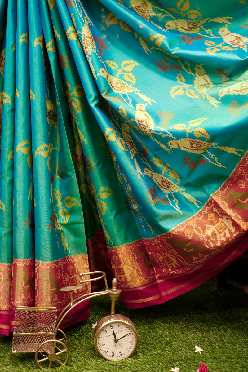 Rajkot patola silk saree dual shade of teal blue and red with golden zari border
