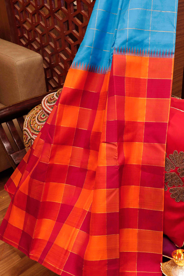 Pure Kanjivaram silk saree blue with orange and maroon with golden zari checked pattern temple design half and half pattern