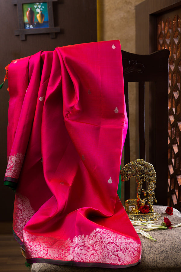 Kanjivaram silk Sarees Dual shade of Pink with Buttas and Floral silver zari border