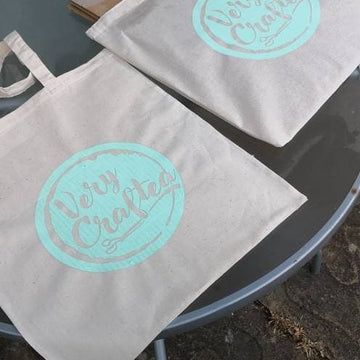 Hand Screen printed recycled cotton tote bag with Very Craftea logo