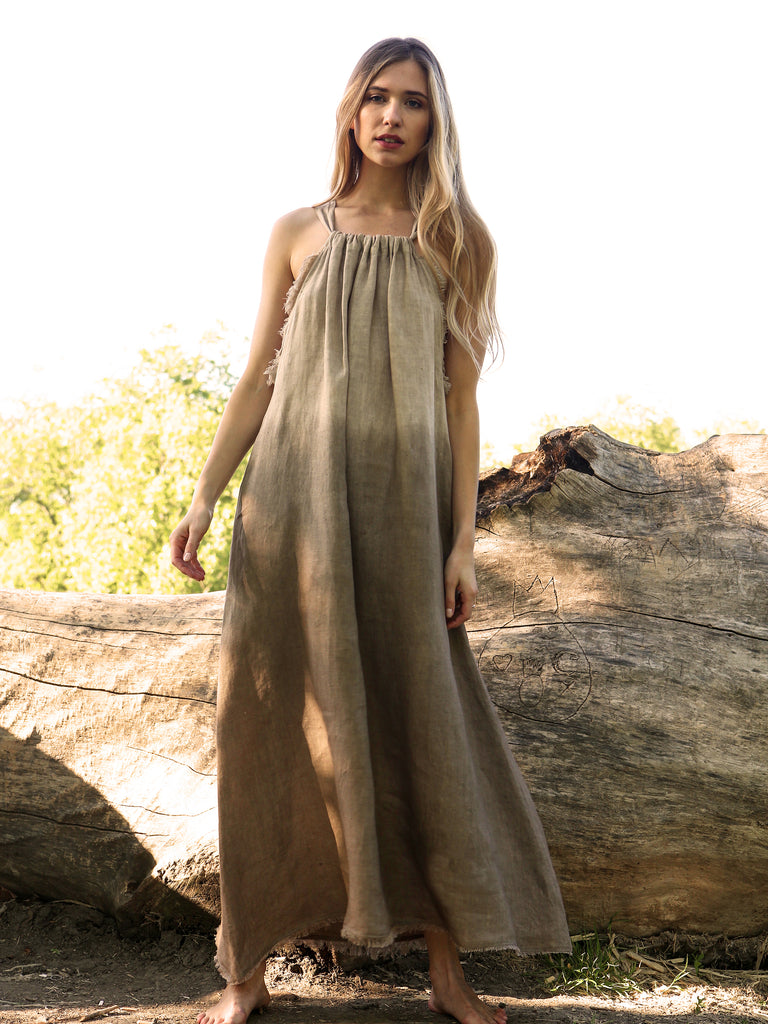 This relaxed and classic maxi dress is crafted from pure linen, easy to wear ties at the back, with fringe details. Slip it on with leather sandals or trainers.