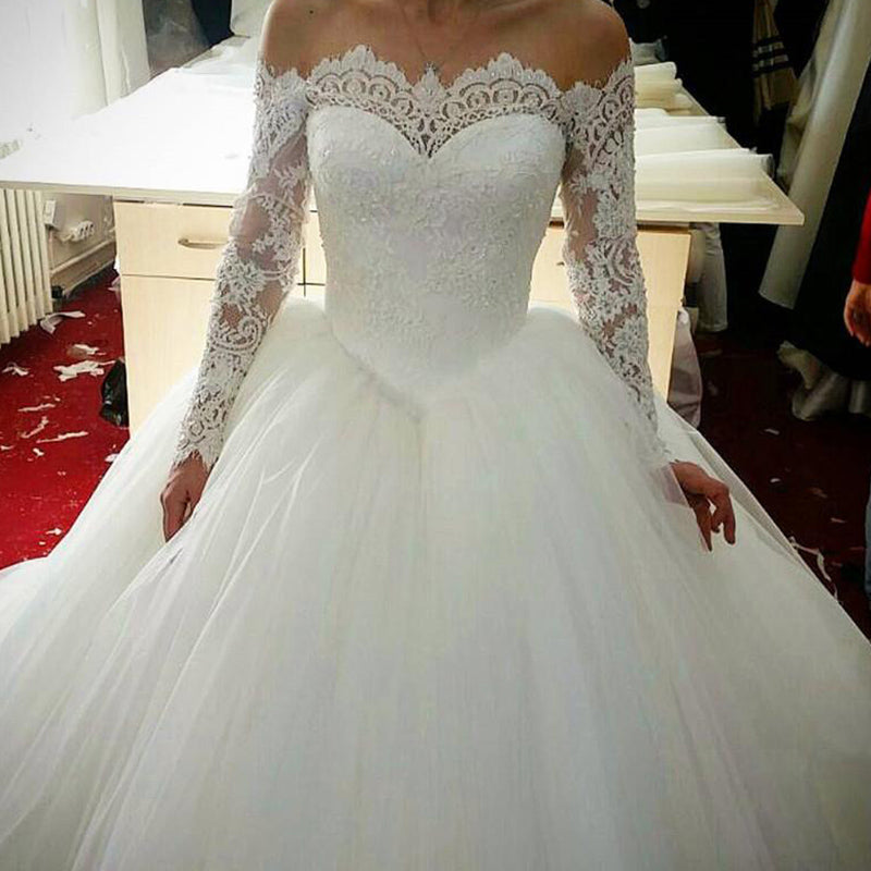 c234cb403068 ... Romantic WD0826 off the shoulder long sleeves Princess Bridal Gown 2018  Poofy Tulle Ball Gown Lace ...