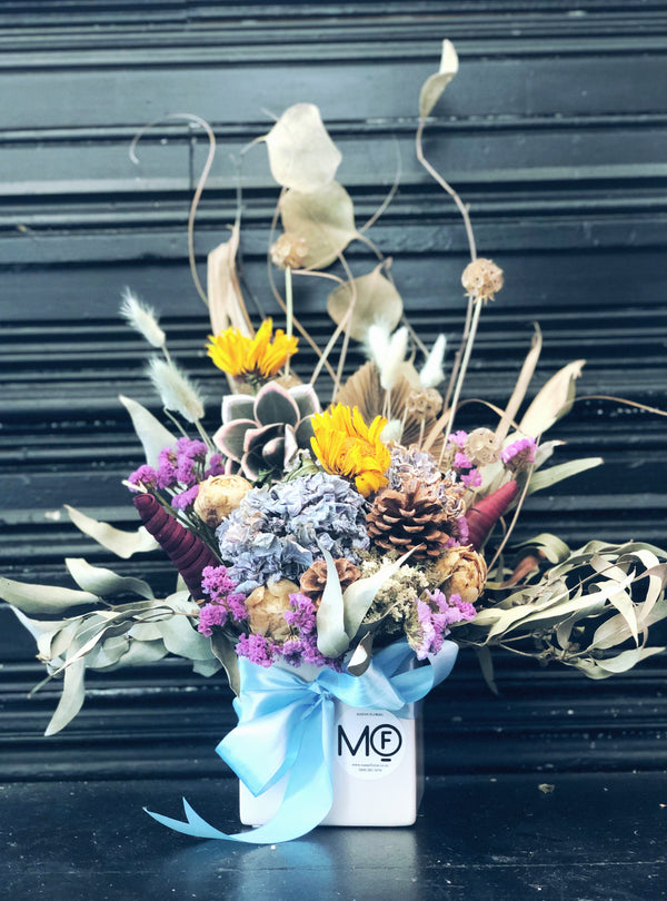 dried flower arrangement yellow and blue