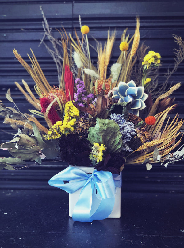 dried flower arrangement blue and bright