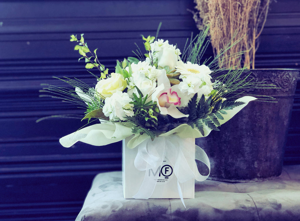 White and Green Fresh Flowers Arrangement in Container