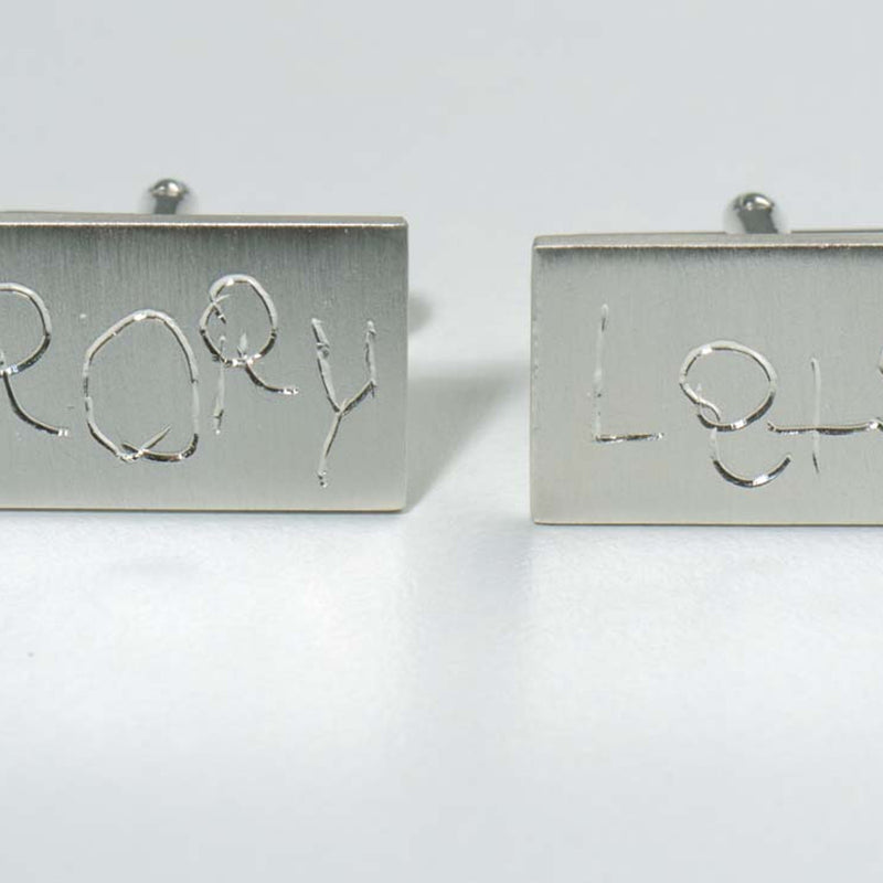 Handmade silver cufflinks with hand engraving