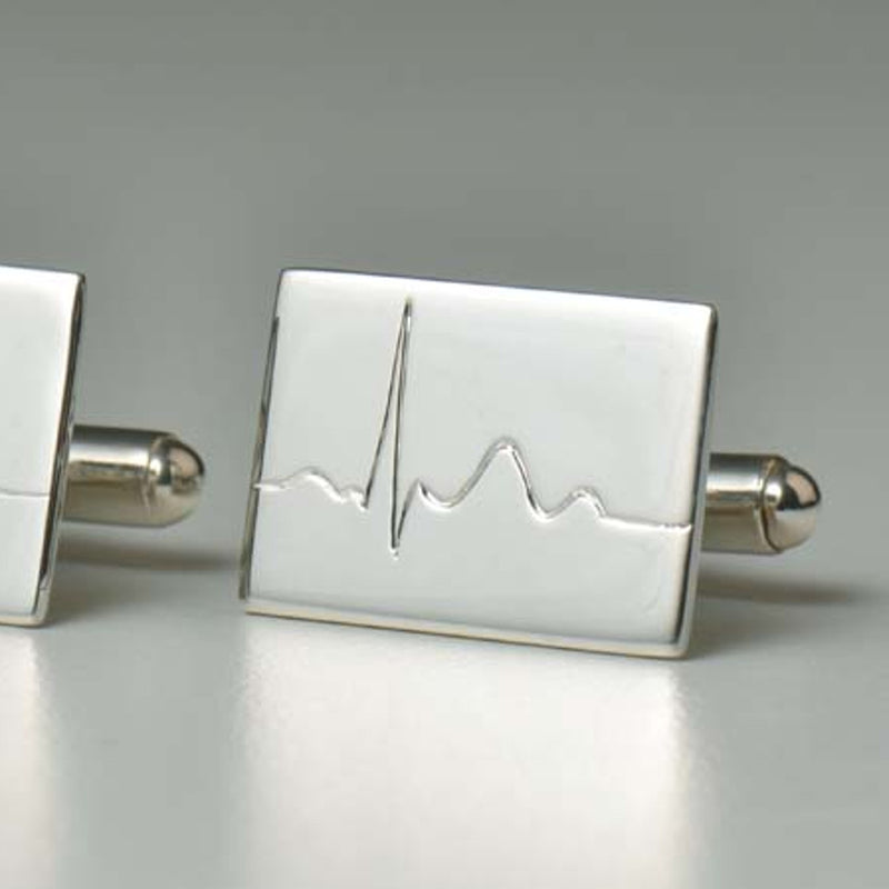 Silver cufflinks handmade for a heart surgeon.