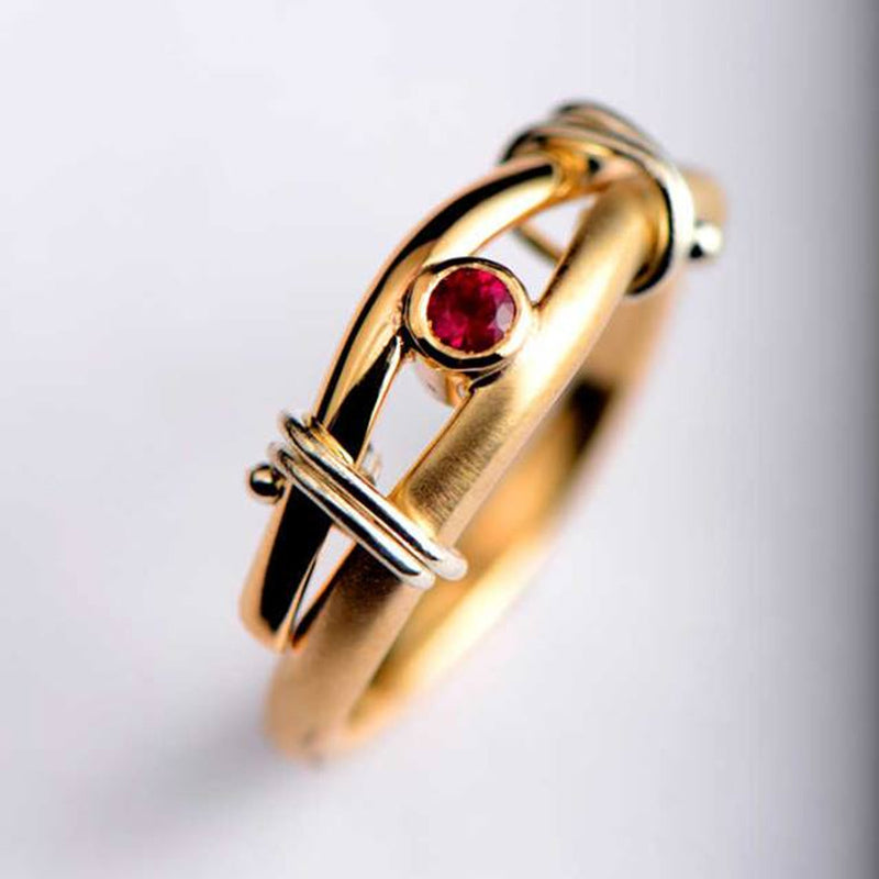 A gold an ruby engagement ring commission