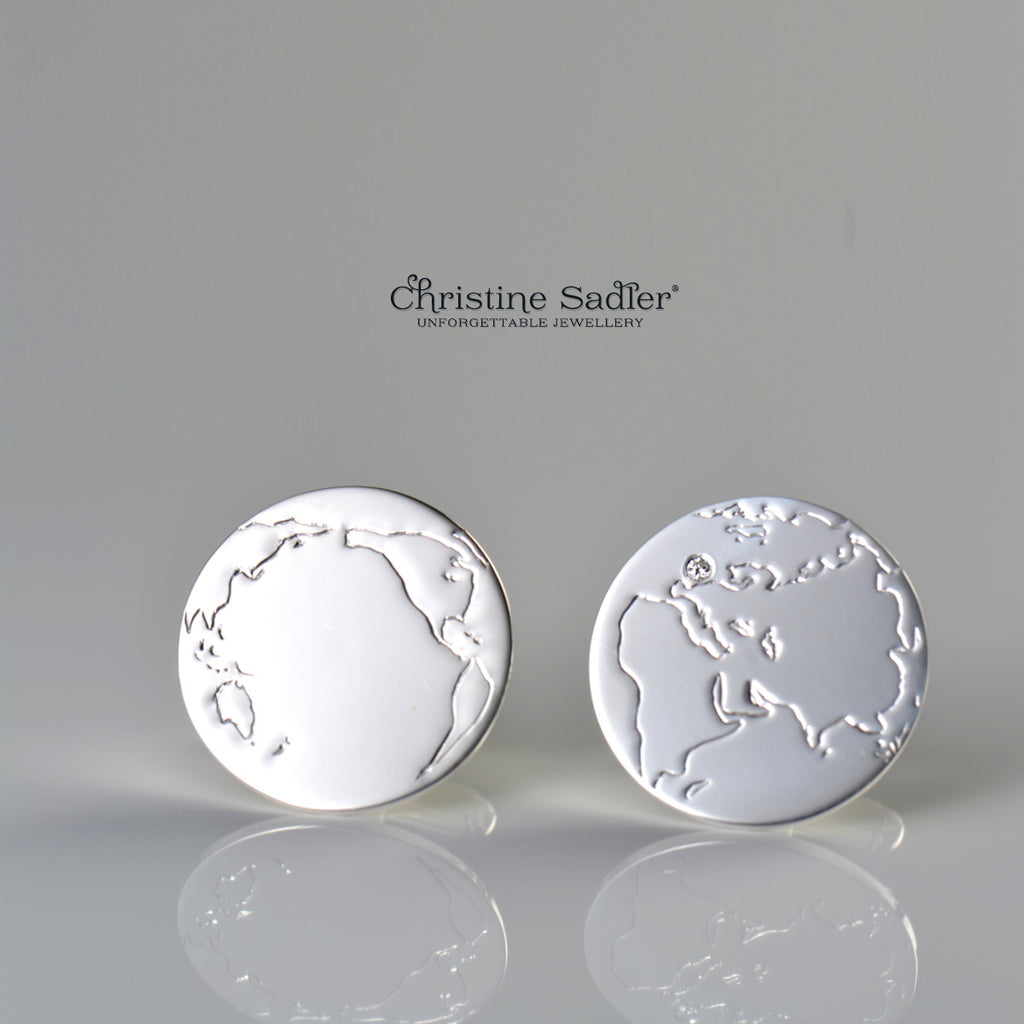 World map cufflinks set with a diamond