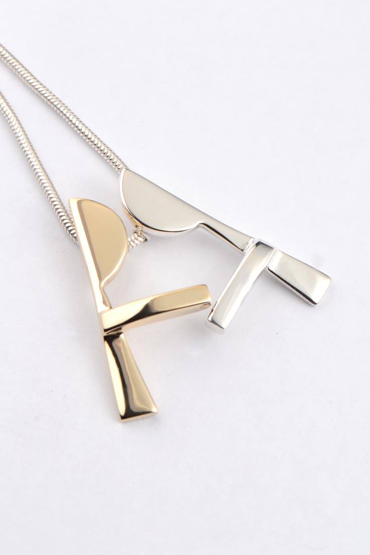 Kiss and Make up gold and silver pendant