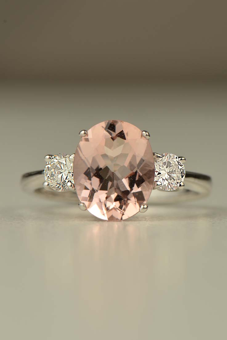 Oval cut morganite with two round diamonds 18ct white gold ring