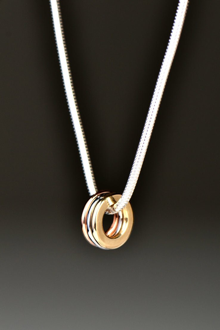 Affinity three coloured gold rings pendant
