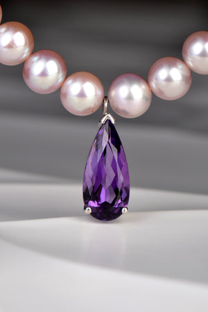 Pink pearls with amethyst tear drop