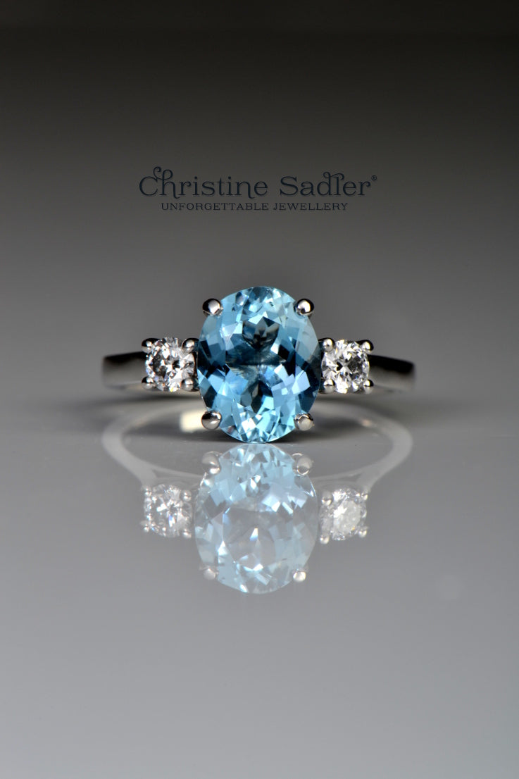Platinum aquamarine and diamond three stone ring