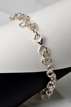 Designer genes silver and 9ct gold bracelet