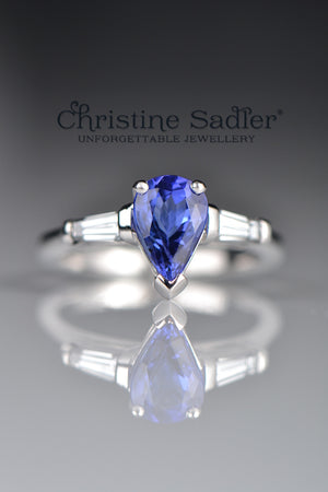 Pear shaped tanzanite and diamond white gold ring
