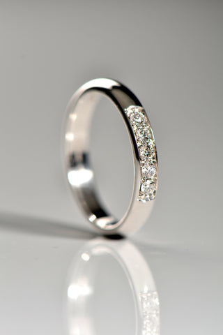 Shaped custom made channel set diamond wedding ring