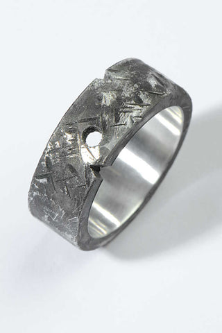 Silver ring with raised centre