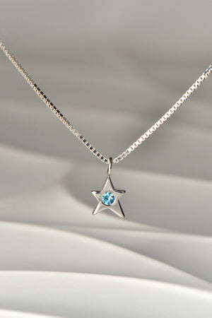 Falling star necklace with blue topaz