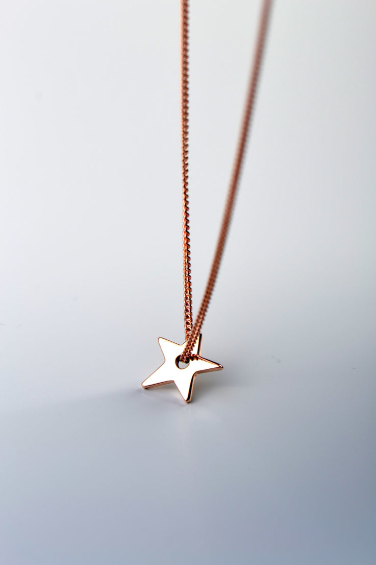 Falling star petite gold necklace