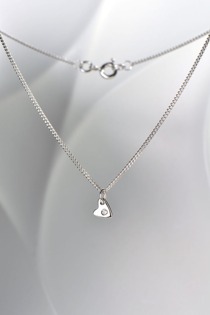 From the heart white gold with diamond heart pendant and earring set