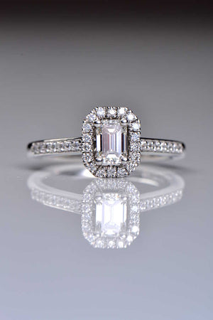 Platinum emerald cut diamond halo ring