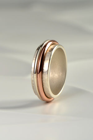 Handmade hammered silver and rose gold ring
