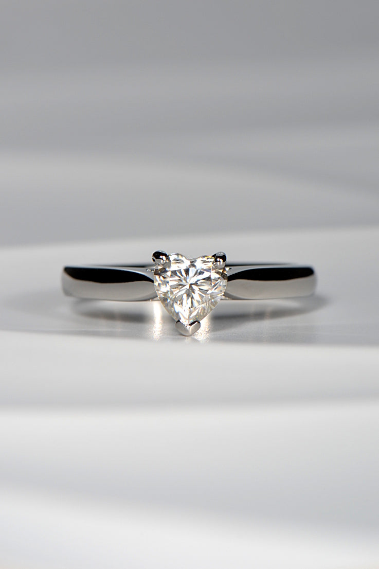 Platinum ring set with heart cut moissanite