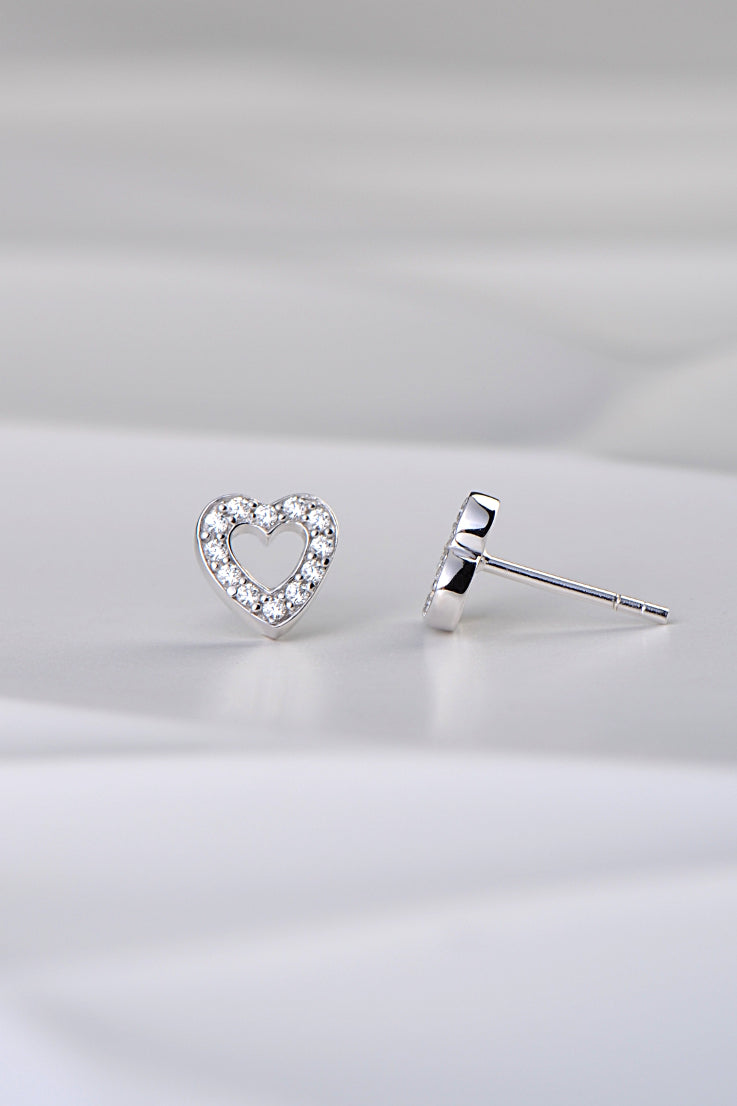 silver outline of heart earrings set with 12 small cubic zirconias