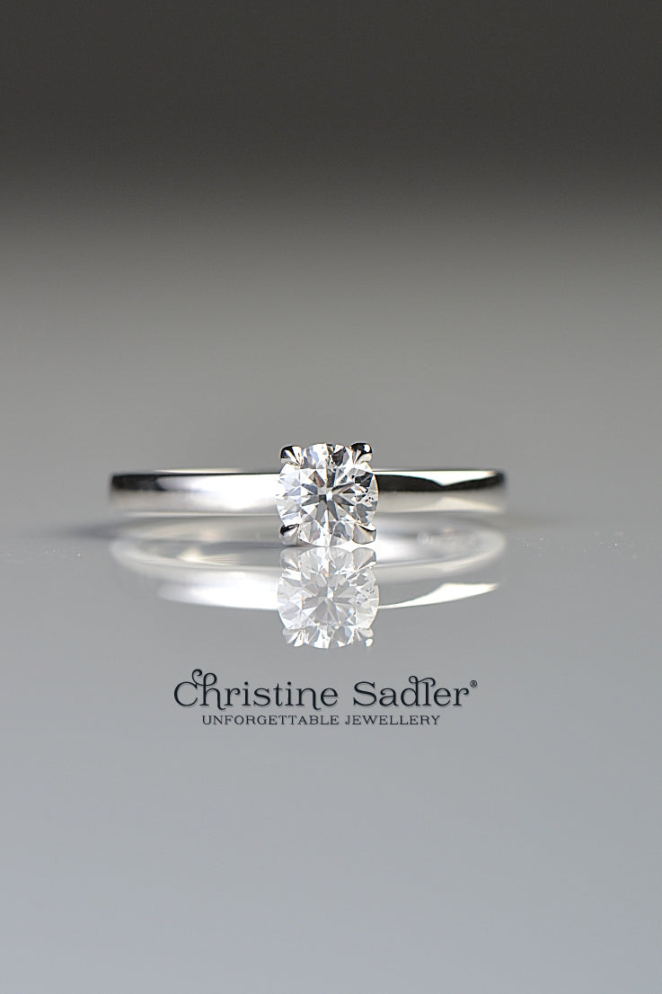 Platinum and diamond ring with side detail