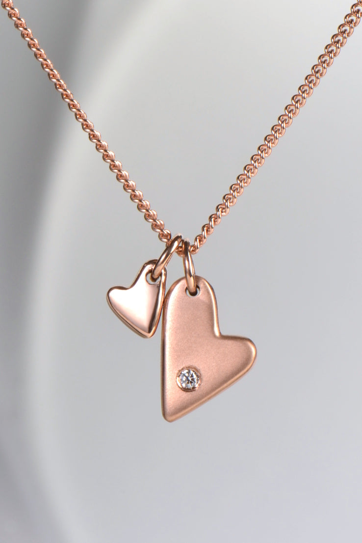 From The Heart 9ct rose gold two heart diamond pendant